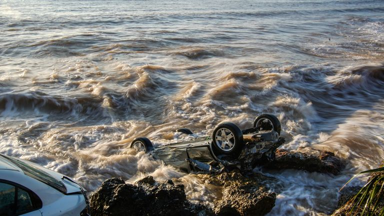 Wrecked cars stuck in the rocky shore of the seaside town of Alcanar, in northeastern Spain, Thursday, Sept. 2, 2021. PIC:AP