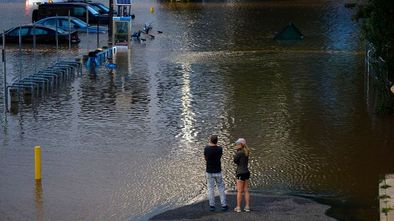 People view a flooded street in Philadelphia, Thursday, Sept. 2, 2021 in the aftermath of downpours and high winds from the remnants of Hurricane Ida that hit the area PIC:AP