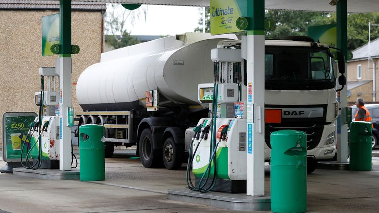 A fuel tanker is parked during a fuel delivery to a BP filling station in Hersham, Britain, September 30, 2021. REUTERS/Peter Nicholls