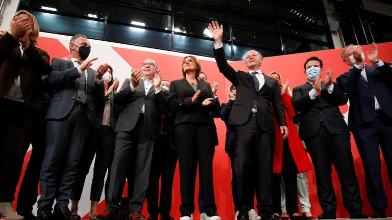 Social Democratic Party candidate Olaf Scholz and supporters at the party headquarters