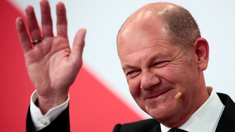 Social Democratic Party (SPD) leader and top candidate for chancellor Olaf Scholz waves after first exit polls for the general elections in Berlin