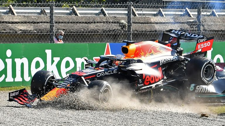 Red Bull's Max Verstappen and Mercedes' Lewis Hamilton crash out of the race