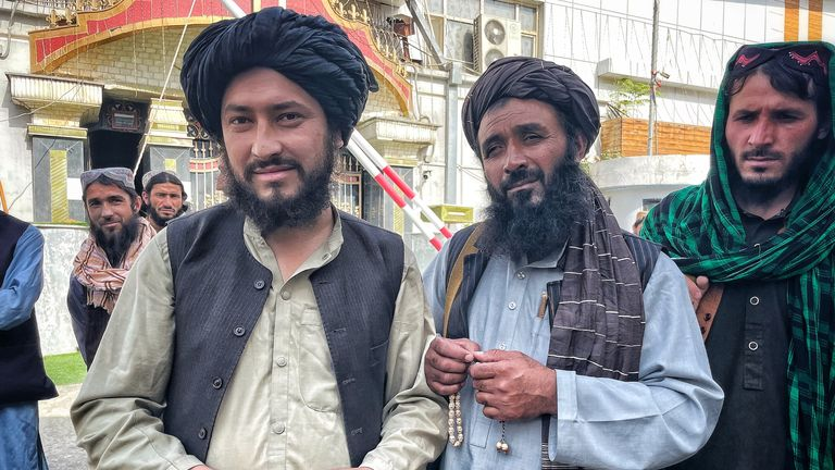 Hafez Sultan Ahmed, left, a deputy Taliban commander
