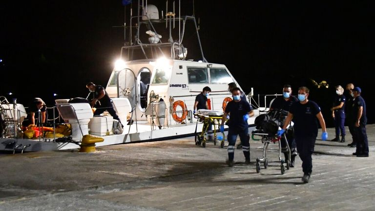 The coastguard recovered the bodies and they were brought to Pythagorio port on Samos. Pic: AP