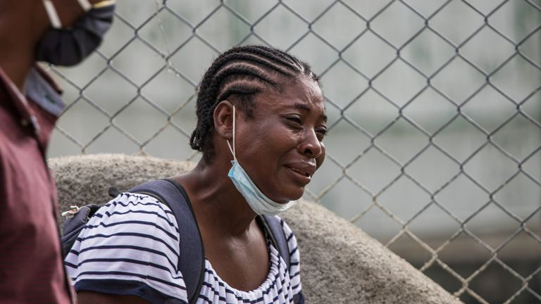 A Haitian migrant who was flown out of Texas by the US arrives in Port-au-Prince, Haiti