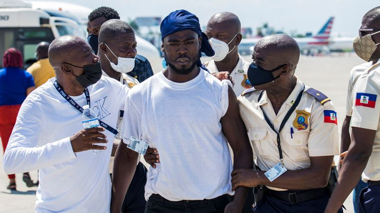 Haitian migrants flown out of Texas arrive in Port-au-Prince, Haiti