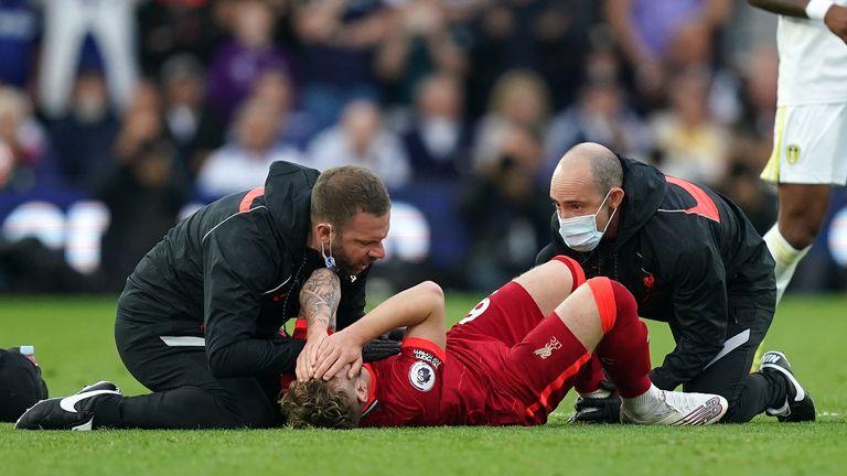 Liverpool's Harvey Elliott receives treatment on the pitch