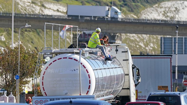 Protesters from Insulate Britain sit on top of a vehicle as they block the A20 in Kent, which provides access to the Port of Dover in Kent.