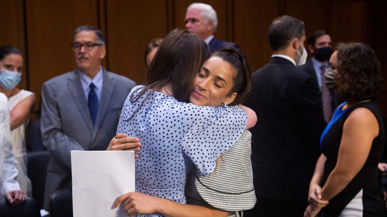 U.S. Olympic gymnast Aly Raisman embraces McKayla Maroney after testifying during a Senate Judiciary hearing about the Inspector General's report on the FBI handling of the Larry Nassar investigation of sexual abuse of Olympic gymnasts, on Capitol Hill, in Washington, D.C., U.S., September 15, 2021. Saul Loeb/Pool via REUTERS