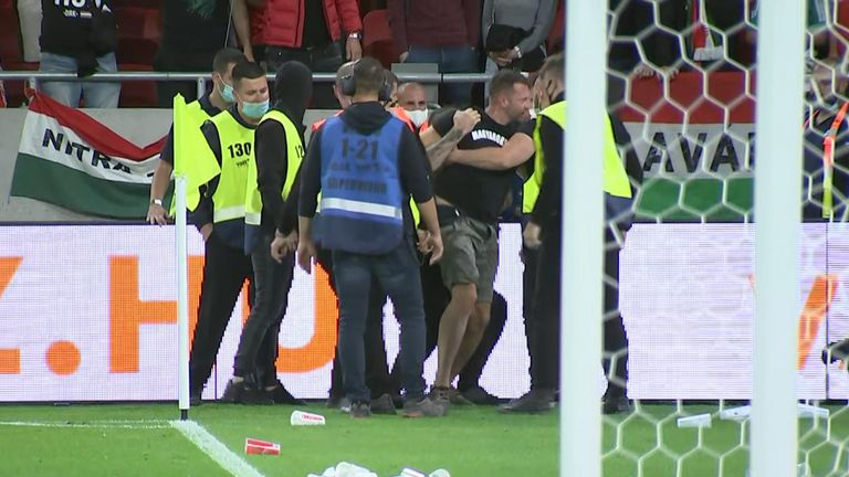 A Hungary fan being led away after the final whistle