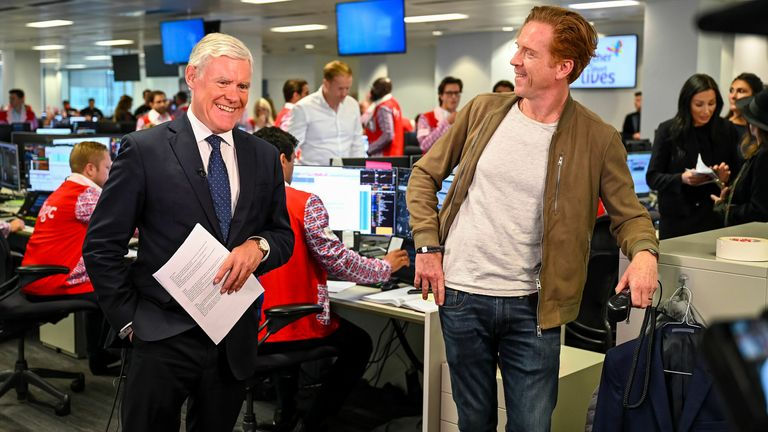 Ian King meets Damian Lewis on the trading floor during the charity day event. Pic: BGC