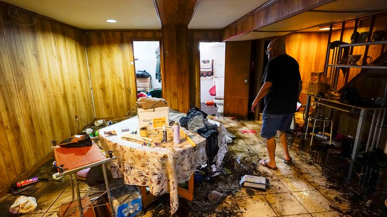 Felix Delapuente, a neighbor of the home in the Queens borough of New York where three people died including a 2-year old child, shows the flood damage in his basement, Thursday, Sept. 2, 2021, in New York  PIC:AP