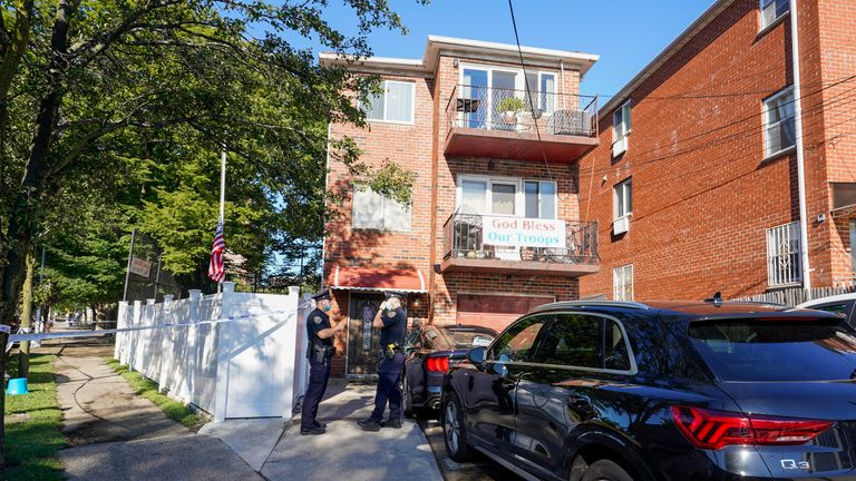 Police officers stand outside a home in the Queens borough of New York where three people died including a 2-year old child when their basement apartment flooded, Thursday, Sept. 2, 2021, in New York PIC:AP