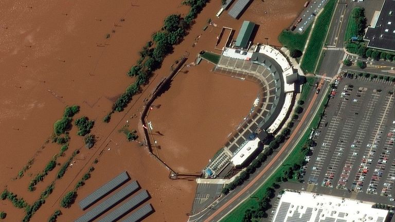 satellite image provided by Maxar Technologies, the stadium for the Somerset Patriots Double-A baseball team is partially flooded by overflow from the Raritan River   NEW JERSEY PIC:AP/MAXAR