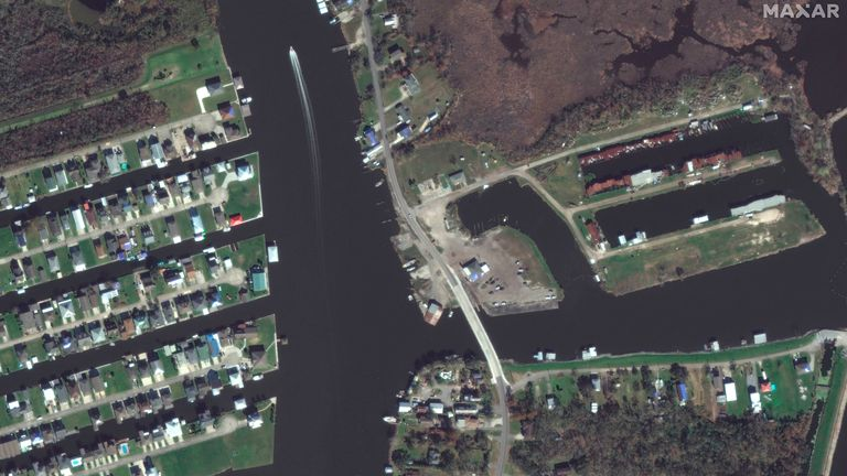 BEFORE IMAGE This combination of satellite images provided by Maxar Technologies shows a closer view of Barataria, La., on Nov. 22, 2020, top, and flooding and storm damage of the same area on Tuesday, Aug. 31, 2021, bottom, following Hurricane Ida.  PIC:MAXAR/AP