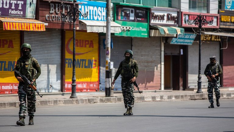 Indian paramilitary soldiers patrol a deserted market area in Srinagar, Indian controlled Kashmir. Pic: AP
