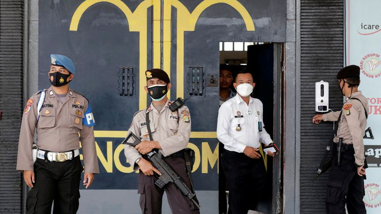 Police officers at the main entrance gate of Tangerang prison