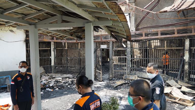 Officials inspect the damage at the prison. Pic: Ministry of Law and Human Rights Indonesia