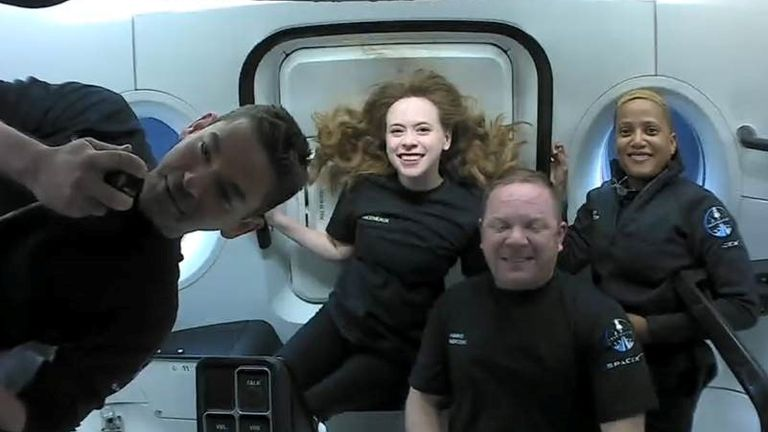 Inspiration4 crew Jared Isaacman, Sian Proctor, Hayley Arceneaux, and Chris Sembroski, seen on their first day in space