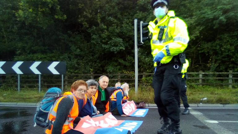 Insulate Britain activists are seen blocking part of the M25 yesterday