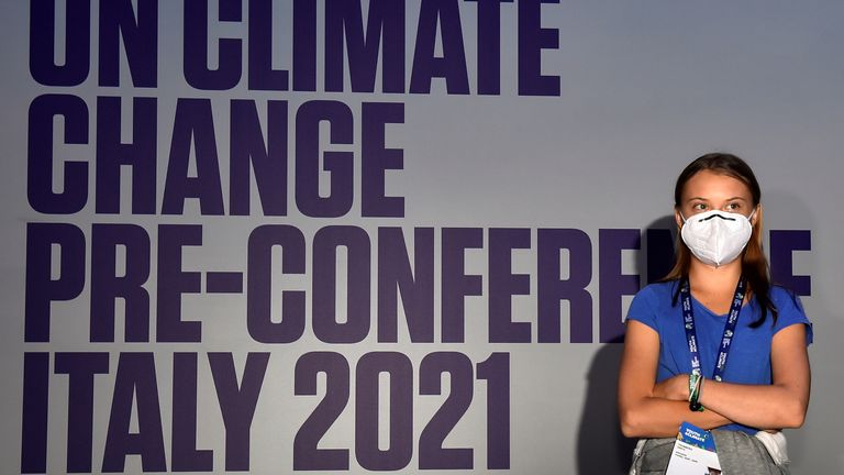Swedish climate activist Greta Thunberg looks on as she speaks during the Youth4Climate pre-COP26 conference in Milan, Italy, September 28, 2021. REUTERS/Flavio Lo Scalzo