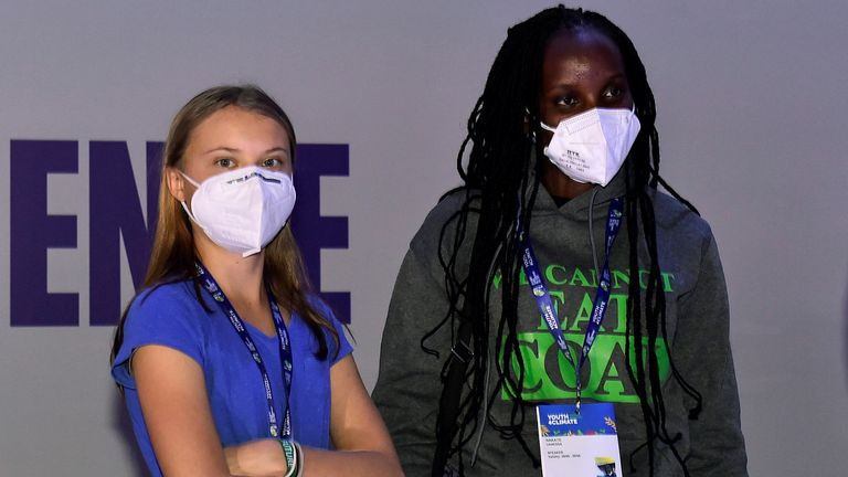 Climate activists Greta Thunberg and Vanessa Nakate attend the Youth4Climate pre-COP26 conference in Milan, Italy, September 28, 2021. REUTERS/Flavio Lo Scalzo