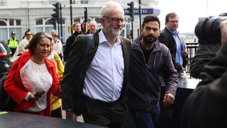 Britain's Labour Party former leader Jeremy Corbyn arrives with his wife, Laura Alvarez at a Fringe event, in Brighton, Britain, September 28, 2021. REUTERS/Hannah McKay