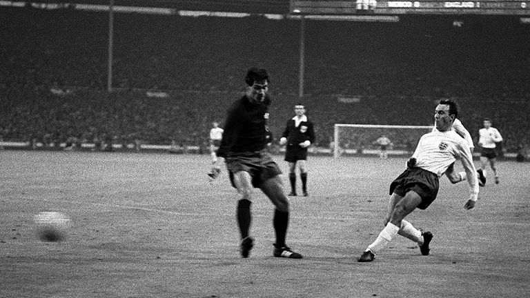 Greaves shoots the ballpast a Mexican defender during the England v Mexico World Cup group match at Wembley Stadium. England won 2-0