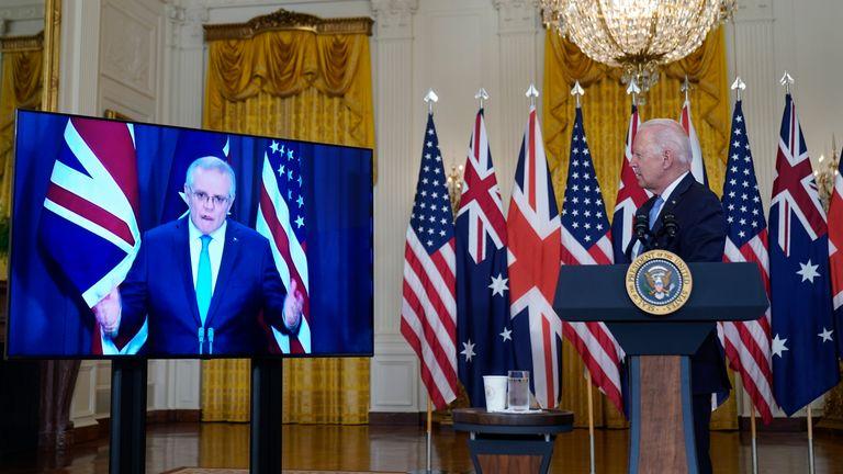 US President Joe Biden listens to  Australian Prime Minister Scott Morrison as the alliance is announced. Pic: AP