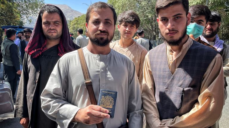 Afghans wanting to leave. One holds a British passport