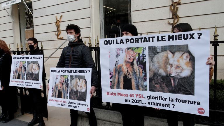 Activists held pictures of Moss in a fox coat alongside an image of a captive fox in Paris in March