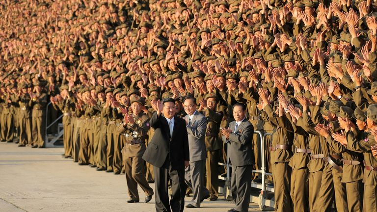 Kim Jong Un greets military members on the 73rd anniversary of the country's founding, in Pyongyang on 9 September