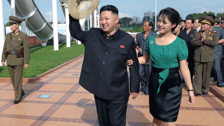 2012 july .FILE - In this July 25, 2012 file photo released by the Korean Central News Agency (KCNA) and distributed in Tokyo by the Korea News Service, North Korean leader Kim Jong Un, accompanied by his wife Ri Sol Ju, waves to the crowd as they inspect the Rungna People's Pleasure Ground in Pyo................................................................................................................................................