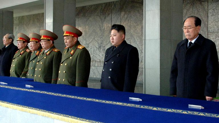North Korea's new leader Kim Jong-un (2nd R) looks on, as he is flanked by President of the Presidium of the Supreme People's Assembly of North Korea Kim Yong-nam (R) and Chief of General Staff of the Korea People's Army Ri Yong-ho (3rd R), during the memorial for late North Korean leader Kim Jong-il in Pyongyang, in this KCNA picture taken on December 29, 2011 and released on December 30, 2011. North Korea's military staged a huge funeral procession on Wednesday in the snowy streets of the capi
