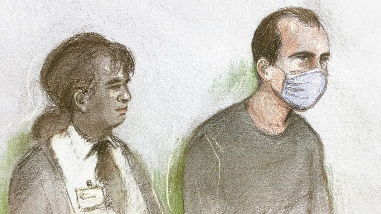 Selamaj is pictured in a court sketch alongside a prison officer on Tuesday