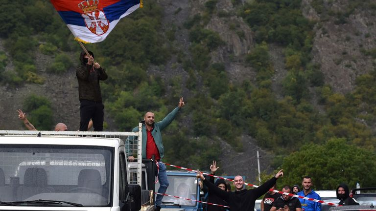 Drivers waved a Serbian flag as they protested against the government ban on entry of vehicles with Serbian license plates