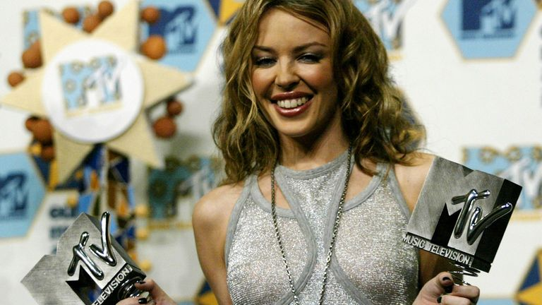 Kylie Minogue with two awards - best pop and best dance artist - at the MTV Europe Music Awards in Barcelona in November 2002
