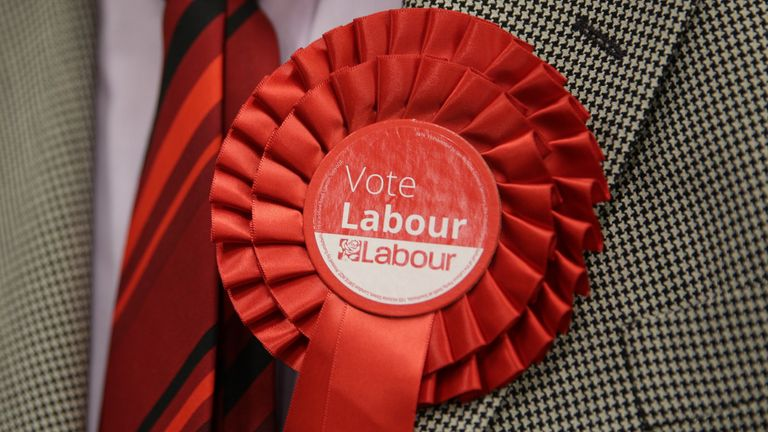 """File photo dated 6/5/2016 of a man wearing a Labour rosette. Labour's leadership battle descended into acrimony as Jeremy Corbyn came under renewed criticism and one of his key allies was accused of calling voters """"stupid""""."""