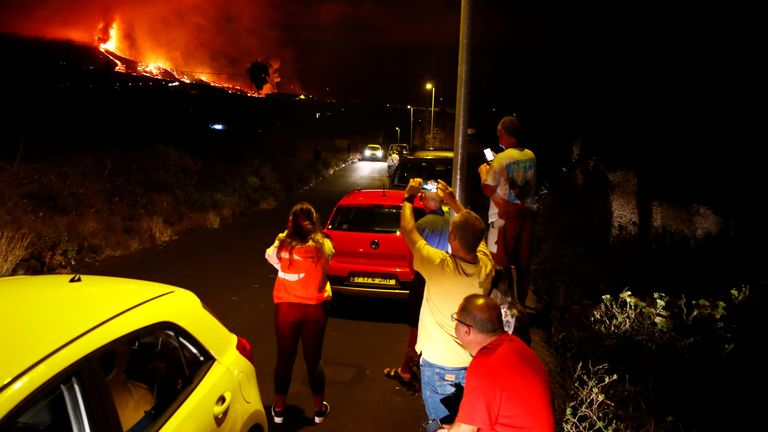 Residents watch lava following the eruption