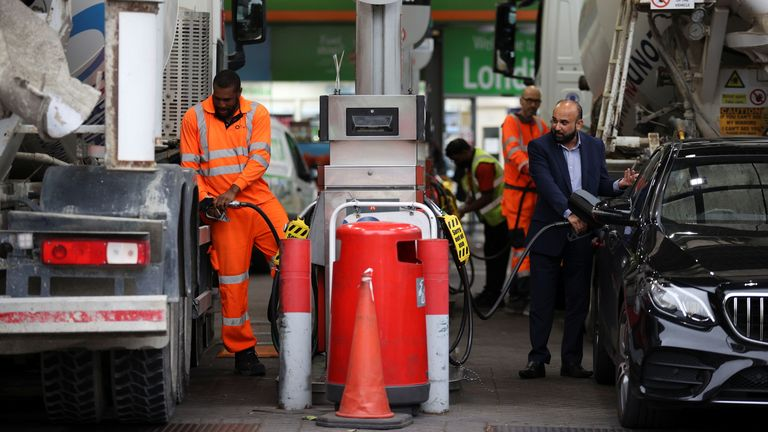 People refuel their vehicles at a fuel station in London, Britain, September 30, 2021. REUTERS/Hannah McKay
