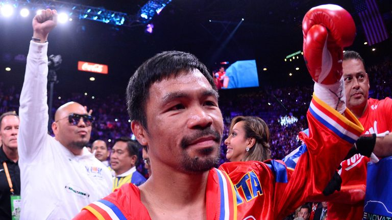 FILE PHOTO: Jul 20, 2019; Las Vegas, NV, USA; Manny Pacquiao enters the ring to face Keith Thurman (not pictured) for their WBA welterweight championship bout at MGM Grand Garden Arena. Pacquiao won via split decision. Mandatory Credit: Joe Camporeale-USA TODAY Sports/File Photo