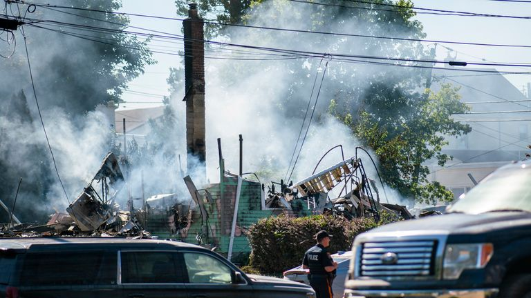 A Manville Police Officer stands guard near the remains of a house that exploded due to severe flooding from Tropical Storm Ida in Manville, NJ., Friday, Sept. 3, 2021. Pic: AP