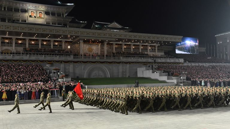 Soldiers march during a paramilitary parade held to mark the 73rd founding anniversary of the republic at Kim Il Sung square in Pyongyang in this undated image supplied by North Korea's Korean Central News Agency on September 9, 2021. KCNA via REUTERS