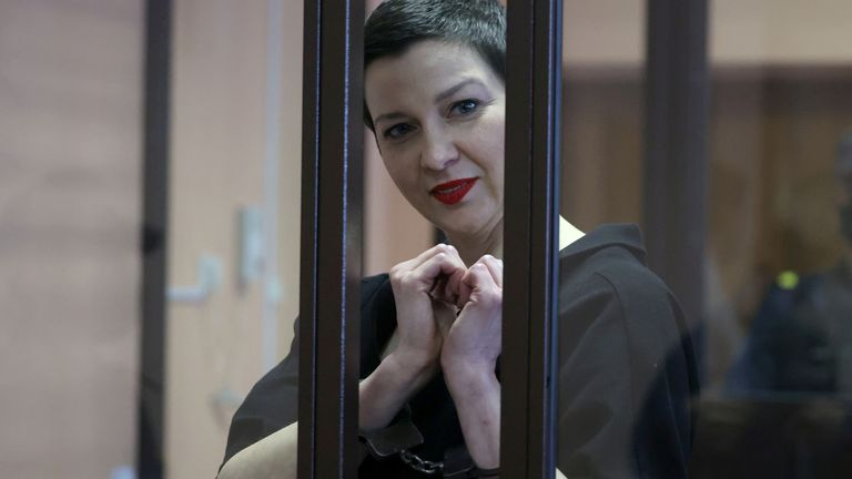 Kolesnikova was charged with extremism and trying to seize power illegally. She gestured inside a defendants' cage as she attended a court hearing in Minsk