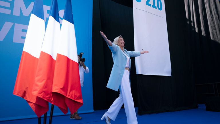 Marine Le Pen arrives at a National Rally event in Frejus, Sunday, Sept. 12, 2021. French far right leader Marine Le Pen hands over the reins of her party to focus on her campaign for the April presidential election, and the Socialist mayor of Paris declares she is joining the 2022 race. (AP Photo/Daniel Cole)
