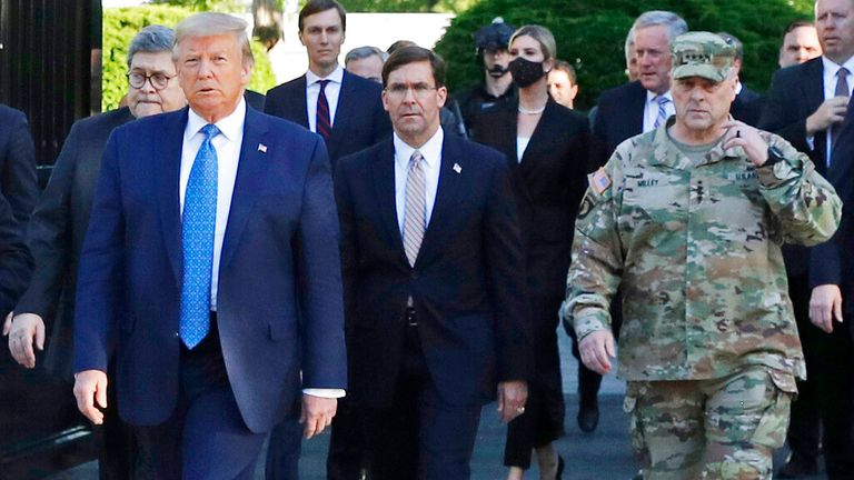 President Donald Trump outside the White House in June 2020 with officials including Gen Mark Milley (R)