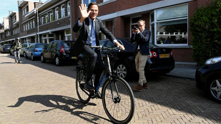 Mr Rutte can be seen cycling to and from his offices in The Hague (file pic)
