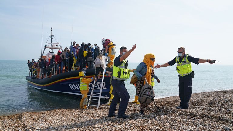 A group of people thought to be migrants are brought ashore from the local lifeboat at Dungeness in Kent, after being picked-up following a small boat incident in the Channel. Picture date: Monday September 6, 2021.