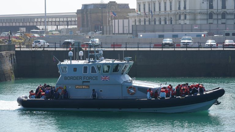 A Border Force vessel brings two large groups of migrants ashore in Dover