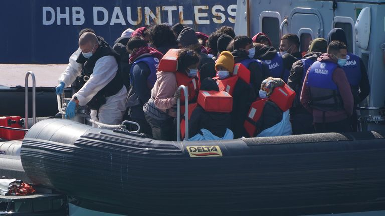 The arrivals, all thought to be migrants, are seen wearing masks and life jackets